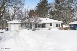 """Charming three bedrooms, two full baths updated home on the Northwest side of Grand Rapids. This area is very popular due to its proximity to downtown Grand Rapids and its beauty.  The fully developed trees in the summer are majestic, and in the winter, the snow graces them with a fluffy coating that is like something you would only see in pictures.  The drive to your new home will always be a pleasure. Two beds and one full bath on the main level; one bedroom and a full bath on the lower walk-out level. It was lovingly updated with new flooring downstairs,  paint, and appliances, to name a few items. The yard is enormous!! It's so difficult to find the privacy you so desire in the city. Sellers have instructed broker to hold offers till 2/22 12pm Are you looking for a space for your outdoor pets? Well, plenty of space for the fur babies to run while you watch them play sitting on your back deck that is two years new. In the summer months,  you will enjoy the tulips, wild berries, and the stunning hostas that surround the home, as well as sitting around the fire pit out back. One stall attached garage - and another garage-like outbuilding a few yards awayplenty of space for those recreational vehicles or gardening supplies. Many new places are opening up on the west side: restaurants, comedy theaters, breweries, and shopping.  There is a reason the locals call it """"west side is the best side,"""" You're not just buying a home but a cool way of life. The possibilities are endless when purchasing this home!"""