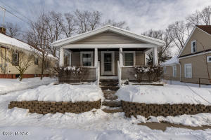 You'll love the convenient location of this Riverside Park area bungalow. It's close to downtown GR but on a quiet cul-de-sac.   The three season porch is a lovely place to relax, entertain and watch your pup or your children play in the fenced back yard. It's cute as button and full of charm! Highest and best due by Sunday Feb 21 at 5pm.