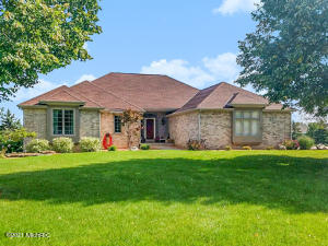 Welcome home to this low-maintenance brick and cedar executive ranch in Hudsonville schools.  Both the main level and lower living area have been expanded to create a more open layout, offering approximately 4,000 square feet of total living space.   Pride of ownership is evident throughout.  Since 2018, numerous upgrades and finishes have been made to the home including a new roof, new low-e windows, 98% efficiency furnace, composite decking, bamboo floors, granite countertops and underground sprinkling system to name a few.  Evenings can be spent near the fireplace in the main living area, in the recently renovated downstairs living area with wet bar, or on the back deck with steps down to the patio and large 3/4 acre lot.  Other highly desirable features include a spacious master suite with walk-in closet and main floor laundry.  Schedule your showing today! Offers due by Tuesday 2/23 @ 5pm, to be reviewed that evening.