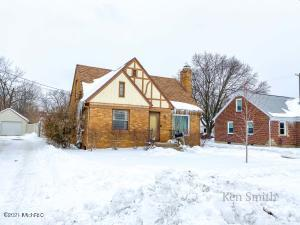 Spacious brick 3 bedroom cape cod in great Wyoming neighborhood. Large living room with wood burning fireplace, full dining room or home office, open kitchen with breakfast nook and main floor master bedroom. The lower level is unfinished with room for a future rec room.  Wood floors, two stall garage and roomy fenced back yard with patio, firepit and playset.  All this on a nice quiet street just a short walk away from Wyoming Junior High. Seller has directed Listing Agent/Broker to hold all offers until 2 pm on Friday 02/26/21.