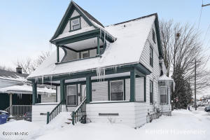 Come take a look at this large spacious home that is move in ready! This home has a new kitchen and bath, replacement windows and a 5 year old roof. Another bonus, a nice 1 stall garage. The home is centrally located to downtown Grand Rapids and has easy access to the highway for easy commuting. Perfect for a residence or rental.