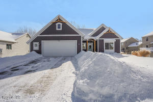 A better than new home now available on the NW side of Grand Rapids!  This 2017 build offers 4 bedrooms and 3 full bathrooms with a walkout basement.  The main level features an open floor plan.  The kitchen includes stainless steel appliances and a large pantry.  Off of the 2.5 stall garage is storage as well as a full bathroom with a vessel sink and tile shower along with the laundry room area.  The main level is rounded out with the main floor master suite including a dedicated bathroom and walk-in-closet as well as a second bedroom.   The walk out basement was just finished!  Downstairs you will find two more bedrooms, a full bathroom and rec room area which is plumbed for a wet bar or kitchenette.  This custom built home is available for the first time! Schedule your showing today!  Showings start 2-24-2021 at 3pm.
