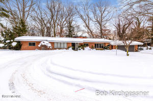 VERY RARE OPPORTUNITY. Mid Century modern, 3000 sq ft brick 1-story, designed by James Bronkema & built in 1956. This private home is tucked away on a 1+ acre wooded lot at the end of a quiet cul-de-sac. The open floor plan features a spectacular, vaulted great room with floor to ceiling windows, fireplace wall & ash hardwood floors. The unique hearth room, with 2nd fireplace & wetbar, connects to an efficient kitchen and opens to a spacious sunroom with walls of windows. The large owner's suite includes a walk-in closet, dressing area and adjacent office. 2 additional oversize bedrooms flank the family bath. The remaining floorplan consists of a main floor laundry, mudroom, attached 2 stall garage and full basement w/ rec room, fireplace & full bath. Located in the heart of EGR, along the Silver Creek Trail, this site is walkable to schools, Gaslight Village and Reeds Lake. With a site that can accommodate any size addition or outdoor living, the renovation of this well designed and constructed home will be well worth any investment.