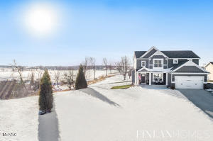 By seamlessly combining a board and batten classic elegance with contemporary comfort and style, this 2018, four bed/2.5 bath KBH Home - in the Caledonia school district - has both outdoor living appeal with beautiful common areas. Added depth and richness in new lighting accents throughout the main floor create an upscale ambience for the foyer, office, fireplace reboot and new carpeting. Four upstairs bedrooms feature a master suite and convenient laundry room. Revel in the gorgeous backyard views, sunsets and expansive outdoor space on this 1.2+ acre cul de sac lot with new hardscape areas, a newly added basketball court and 16'W x 20'L out building. Potential for a fifth bedroom, bathroom and large living space await on the lower level, making for a must see property all around! Offers, if any, to be reviewed no sooner than Monday, March 1 at 3:00 PM