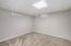 den/ office in basement . egress window would create another bedroom