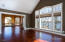 Main floor family room with view to the sunroom.