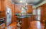 Kitchen with cherry floors, stainless appliances