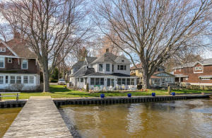 Lake Macatawa waterfront home in an ideal south side location near Holland's famous channel, which leads to world class boating, recreation, Lake Michigan, and endless memories. This 1930's year round home includes the charm of yesteryear and was essentially rebuilt. This cottage features beautiful hardwood floors, inviting great room with incredible lake views, cozy fireplace, a gourmet kitchen with subzero refrigerator, gas cook top and double wall ovens. There is a bonus room on the main floor, office, den or 5th bedroom as it is currently being used. Upstairs you will find a lovely master suite with loads of closet and work space. The Master also features an Ensuite with shower and Jacuzzi tub, rounding out the upstairs you'll find three additional large bedrooms and bathrooms.