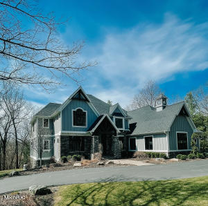 Welcome home to this Complete Custom rebuild in 2016-Gorgeous private 2+acre setting with mature trees,beautiful landscaping and circular drive. Hi-end finishes and custom details to accent the living space. Main floor Office with unique 'crow's nest loft'.Open vaulted ceiling with stone fireplace and perfect wooded views. 10' ceilings throughout main level.Open kitchen with luxury appliances,walk-in pantry, dining area and sun room. Two main floor bedrooms with shared full bath-all bedrooms have walk-in closets.  Upper features the master suite of your dreams-vast closet, tile shower, soaking tub;two more bedrooms with bath between. Lower level made for entertaining with bar area, family room, home gym and theater room. Award winning Forest Hills Eastern and just minutes to Knap's Corner. New Generac whole home generator in 2020 and new septic 2015. Call today for a private showing!
