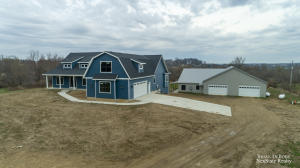 New construction on 4.58 acres in Jamestown Township! 2,600 square foot home with 4 bedrooms and 2.5 baths on the main floor... plus office space!  So many beautiful features on this home! Gorgeous kitchen with center island and stunning counter tops.  Decked out fireplace in the living room.  Just wait until you see the Master Bathroom! Bonus room above the garage ready to be finished.Basement is currently unfinished but has so much opportunity. Full concrete room under garage that can be used as a cellar or storm shelter... or gun/archery range! Now lets talk about this barn!  5,500 square foot of pole barn (50'x110') that is sitting on footings and poured wall. Solid as they come!  BARN HAS 1,400 SQUARE FEET OF LIVING SPACE that can be convert to office space or used as guest quarters One year builder home warranty.Barn was completed in 2018/2019.