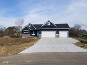 You can't beat Brand New Construction! How about on over an acre? Welcome Home to 5295 Greyfield Ct. in Hudsonville. 1829 sq foot on the main floor with 3 bedrooms and 2.5 bathrooms. Enter in through the front door to open concept living, with tall cathedral ceilings! Off the mudroom, you will find a half bath, the laundry room, and beautiful master suite over looking the creek out back. The other side of the home has 2 additional bedroom and a full bath. Head downstairs to a unfinished walkout lower level. All of this within the sought after Hudsonville School District. There are no more lots available in Fox Meadows! Don't miss out on this opportunity!