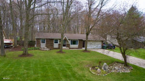 Beautiful ranch in Tallmadge township, Grandville Schools!  Large lot with fenced back yard and wooded back drop.  This one stands out with a nice kitchen with stainless appliances open to a large living room with vaulted ceilings and lot of windows for natural light.  Full living room up front as well that can be a play room or dining room.  Main floor also features 3 beds and 1.5 baths.  Downstairs has a nice rec area, a non-conforming room and a large storage room with laundry.  Back yard is great with a deck, fire pit area and shed/barn for all the garden equipment and storage.  Showings start Wednesday.  All offers due by 3:00 PM on Saturday 04/17/21