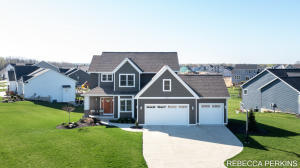 **Per Seller instruction: Highest & best offers due by 12pm Friday, April 16th. No offers accepted before deadline. Response by Friday evening.** Move-in ready home in Hudsonville Schools! On .43 acres, this 5 bedrooms & 3.5 bath is situated in the Hickory Grove neighborhood. Built in 2018, this modern home has open-concept living on the main floor w/ 9 ft ceilings, fireplace, & plenty of natural light. Kitchen features stainless steel appliances, granite countertops, & a walk-in pantry w/ barn door. Also located on the main level are the office(5th bedroom), 1/2 bath, mudroom entrance. Upstairs offers 3 bedrooms w/ a HUGE master suite w/ vaulted ceiling, tiled shower w/ 3 shower heads, & walk-in closet! Finished, walkout lower level is complete w/ rec room bedroom, & full bath.