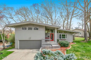 This East Grand Rapids mid-century modern home offers an updated interior and convenient, walkable location to both Gaslight and Breton Village. The open concept main floor has a spacious living room with vaulted ceilings, fireplace, dining area, office, and updated kitchen with walk-in pantry. The owners' suite is updated with floating cabinets and a tiled, rain head shower. The walk-out family room features an updated half bath and glass 3-season sunroom which opens to the backyard. The lower level recreation room is finished for additional living space, storage and laundry. The exterior offers a multi-level deck with a fenced yard, mature trees, a nice lawn area, and a newer roof. Any and all offers to be reviewed at 5 pm on Tuesday, 4/20.
