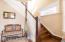 A foyer ushers you into the living area or upstairs with a beautiful grand staircase