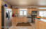 The spacious kitchen offers lots of storage space with many recent upgrades