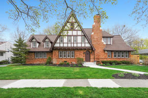 Location is key with this beautiful central entrance Tudor. Walk to Breton Village where you will find upscale shopping, groceries, coffee, and restaurants. Schools, Gaslight Village and Reed's Lake are also located within walking distance from this home.  This lovely home features well preserved architectural details throughout. Iron detailing on the main staircase, high coved ceilings, marble, and oak floors, all add to the homes character. With almost 3,000 sq. ft. of living space, this is an ideal home for entertaining. This home features a fabulous formal living room with an exquisite fireplace that is the centerpiece of the room, office/library with private entrance from the beautifully manicured secluded back yard, lovely formal dining room, kitchen with new appliances, walk-in pantry, and dining area. A powder room completes the 1st floor. Upstairs includes 4 beds and 2 full baths. The oversized master bedroom is a delightful retreat, including 2 closets, hardwood flooring and plenty of windows.  3 more generously sized bedrooms, all with hardwood floors and adequate closet spaces round off the upstairs. The convenient 2nd staircase from the kitchen to the 2nd floor is perfect for home offices, nanny, or guests. The lower-level daylight Family room offers a 2nd fireplace and daylight windows. There is a genuinely nice laundry RM and tons of storage. Brand new roof, New windows, professional landscaping with underground sprinkling are a few of the improvements and upgrades. Please ask to see the extensive and detailed list of all the improvements. This home has been extremely well cared for and loved. Offers presented Monday the 19th at 2pm.