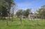 Over 5 acres with vineyard, two houses, pole barn and guest house.
