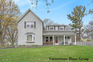 This beautifully updated 1910 farmhouse blends vintage charm with modern elements and upgrades. Abundant natural light showcases the hardwood floors, arched doorways, and custom molding found throughout. Main floor features a kitchen with white cabinets, pantry and cozy breakfast nook; a bedroom, full bath and main floor laundry. Upstairs, find two spacious bedrooms and a full bath.Downstairs basement is unfinished and provides ample storage space or room to expand. Newer roof and windows. Outside find a wonderful front porch with a view.  Also a detached two stall garage with extra storage space, two storage sheds, extra parking, and a fenced-in backyard.  Close to schools, parks, shops and restaurants. Minutes from highways and downtown Grand Rapids. Call to schedule your showing today!Seller has directed listing broker to hold all offers until 12:00 noon Monday April 26. No Escalation Clauses or buyer letters. Please remove shoes, touch only door knobs or light switches if completely necessary, wear masks and maintain social distance, and please follow GRAR's COVID protocols as seen on the documents tab.