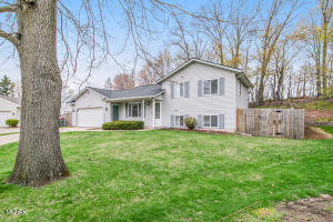 Here's your chance to move right into this lovely 3 bed/2 bath, tri-level home at the end of a quiet cul-de-sac street!  Enjoy an open floor plan, vaulted ceilings, and lots of natural light! The main level offers a living room, kitchen w/stainless appliances (newer refrigerator 2018) & dining area w/sliders out to a private, wooded, fenced (2017) yard w/lovely landscaping & paver retaining walls. Walk up a few steps to the spacious primary bedroom w/French doors & a walk-in closet.  Another bedroom & full bath w/skylight make this floor complete!  The lower level's family room has sliders out to a patio, one more full bed, bath & plenty of storage.  Updates include new furnace (2019) & new roof (2020).  Showings begin Friday, April 23 with offers due Monday, April 26th by 12 PM.