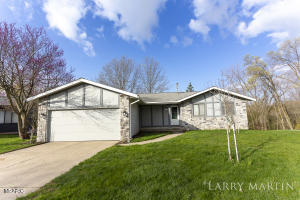 Tons of potential in this 3-bedroom, 2-1/2 bathroom home located on Brooktrails Ct. in Grand Rapids. Sitting on a picturesque lot with deer trails, birds, and a stream, it's a highly desired area, ready for you to call your own! Step inside and you are greeted with vaulted ceilings and a semi-open floor plan that is perfect for entertaining guests. The living room leads to the dining area and kitchen, where glass sliders take you to the deck that overlooks the park-like backyard. The family room has a stone fireplace with custom built-ins. The kitchen is large and offers plenty of space for cooking and all your storage needs. There are two bedrooms on the main level, including the owner's suite with its own private bathroom and private entrance to the deck. Another huge amenity is the main floor laundry. The finished lower level walkout includes an additional living area, wet bar, bedroom, bonus room, storage, and full bathroom. The package is made complete with the attached garage. This is a must see! Schedule your safe and private showing, today!