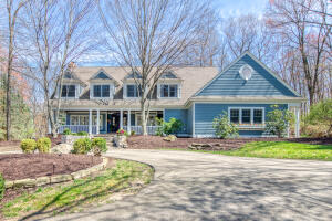 A stunningly beautiful Cape Cod style home located in the desirable Highgrove gated community in the Forest Hills School District.  You enter from an expansive stone front porch into a bright and spectacular 5 bedroom, 4.5 bath, 5726 sq ft home.  Each room throughout the home has large windows that allow for a lot of natural sunlight and views of the wooded setting.  The expansive Main floor offers 2 large living rooms with fireplaces one of them with beautiful wood detailing, sunroom, gorgeous kitchen with an abundance of cabinets, granite counter tops, double ovens, Wolf 5 burner cooktop, sub zero refrigerator,  1/2 bath and main floor laundry. Upper level offers a spacious Master bedroom, with walk-in closets, very chic master bathroom with steam shower, 3 additional large bedrooms and 2 full baths.  Lower level offers a family room with bar area, a large bedroom and full bath, wine cellar, and an additional room that could be used as a game room.  Home sits on almost 2 acres with an upper and lower level stone patio with fire pit. Whole house speaker system that includes outdoor speakers.  Owners have made many lovely updates to the interior and exterior.