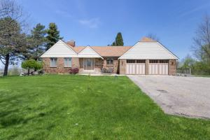 Spectacular panoramic views all around! Almost 5 acres of beautiful property, and one of the highest elevation in Ottawa County, 908 ft. above sea level. On a clear day, you can see Lake Michigan from here! The main floor has a large entry at the front door, with a formal living room featuring built in shelves and a cozy fireplace.   The back of the home offering open plan kitchen with center island, dining area, and a family room - with a fireplace, large windows with amazing views, and walk-out to the deck.  Laundry room, a full, and half bath, and one bedroom can also be found on this level. Upstairs offers 2 additional bedrooms, a full bath, and storage room.  The lower level had a convenient finished room with walk out to the back yard, plus tons of storage room, including a large workshop area. The front of the home has a cute little patio area.