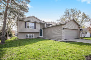 This newly updated, move in ready home is a must see in the City of Walker, Grandville school system! Enjoy an open concept feel on the main floor with cathedral ceilings, kitchen with an island, dining area with sliders to the deck overlooking your back yard! You'll also see 2 bedrooms and a full bath on the main floor.  Walk down to the lower level and see the ample sized laundry/storage room, an office or 3rd bedroom and a cozy family room also with a full bathroom. Come and see the fresh, bright updates this property has to make it your next home! Offers are due on Thursday May 6 by 3:00 p.m.