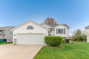 All offers due Monday, 5/10 at 9:00am. Gorgeous bi-level home brimming with big ticket upgrades galore! Positioned in a desirable Kentwood neighborhood, enjoy the new roof (2019), newer kitchen appliances, and newly remodeled finished basement (2021). The main level features a bright open-concept design with a vaulted ceiling and large windows, offering a welcoming atmosphere to all who enter. Entertain any occasion in the sprawling family room with stone gas fireplace, perfect for a media or rec room. Parking pad offers additional space for 3rd car or recreation vehicle. Relax outdoors with friends on the walkout deck with beautiful view of the lush green backyard. Close to dining, shopping, schools, and bike trails. Only one owner--immaculately maintained. All offers due Monday, 5/10 at 9:00am.