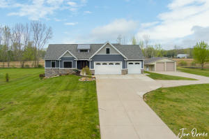 Beautiful, large ranch-style home on 1.5 acres along with a 36x32ft heated and insulated outbuilding. With nearly 3600 sq/ft of finished living space, there's a LOT to love! With 6 bedrooms, 5 bathrooms, 2 full kitchens, vaulted ceilings, a beautiful fireplace, 2x 3-seasons rooms, a spacious main floor master, main floor laundry, & a bonus room above the 3-stall garage, you'll have a hard time picking a favorite feature! The big, open kitchen features a large island, walk-in pantry, &a built-in, side-by-side fridge & freezer. The walk-out basement includes a large rec room & a lovely 3-seasons porch that leads to a beautiful patio and fire pit.Just 9 minutes North of Zeeland High School, you're conveniently close to town, but far enough away to enjoy the peace & quiet of nature. With a zero-step entrance and wide doorways, this home is built to be handicap accessible.You have to come see it for yourself. You'll love it here!