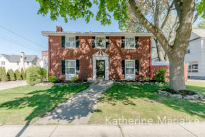 Beautiful, well-built brick home in the heart of downtown Zeeland that has been meticulously cared for and maintained! This 4 bedroom home boasts over 2,600 sq ft, a fenced in private backyard with plenty of deck space for entertaining, a spacious living room with a wood burning fireplace, an elegant formal dining room, and an updated kitchen in 2020 with a large eat-in area, just to name a few of the highlights of this property. Along with being in the downtown parade route, this home is literally steps away from all downtown Zeeland has to offer with its' restaurants, shops, splash pad, library and more! Conveniently located just minutes from I-196, a short distance from downtown Holland, and only 15 minutes from gorgeous Lake Michigan beaches that line the Holland lakeshore.