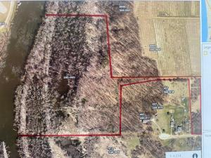 What an opportunity to build on your very own 34 acre parcel with 1400 feet of frontage on the Grand River!  All within 10 minutes of Grand Rapids, Grandville, Jenison and Allendalle.  Properties like this do not often hit the market.  This property offers an opportunity for hunting, fishing, and boating all with ultimate privacy.  Connect with the JKC builders who will convert this land into a beautiful custom built home on the hills overlooking the river and vast woods.  Location, Location, Location on this property.  Call to set up an appointment to see the property and meet with the builder.  Pictures are from similar home the builder has built.  Proposed construction.