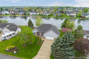 Sprawling waterfront ranch in Bluff Lakes!  Updated inside and out, this 2500 sq ft 4 BR, 4 full BA home is ready for you!!  With 103 ft of frontage, a dock and new seawall, enjoy your summer on the water.  Sunset views from the primary ensuite, LR w/ vaulted ceiling & fireplace, dining area w/ slider to deck, kitchen w/ stainless appliances, lower level 3 season screened porch and more!  Newer roof, furnace, air conditioner, water heater, appliances, flooring, garage door, window treatments and washing machine & dryer in separate laundry room!  So much room with 2 storage rooms and oversized 2 stall garage.  Wired for hot tub if you'd like to put one in!  Fantastic layout for entertaining and living, amazing location near bike paths, downtown Zeeland, schools, parks & more!  Tour today
