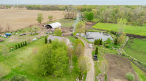 Overview of home, barn and pond
