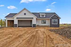 Welcome Home! Ready to escape the hustle and bustle of the city? Or the tight quarters of neighborhood living? This one is for you! Set back off the road on 5 wonderful acres in Blendon Township this beautiful new build is only a couple months out from welcoming its new owner! Featuring a main floor master suite with spacious bath and closet, main floor laundry, cozy fireplace in living room with white oak custom built-ins, White oak lowers in kitchen and white uppers with carrara quartz counter tops, the list goes on and on! All of this while also having 40+ acres of Blendon State Game area just steps away to enjoy at your leisure! Call for a private tour today.