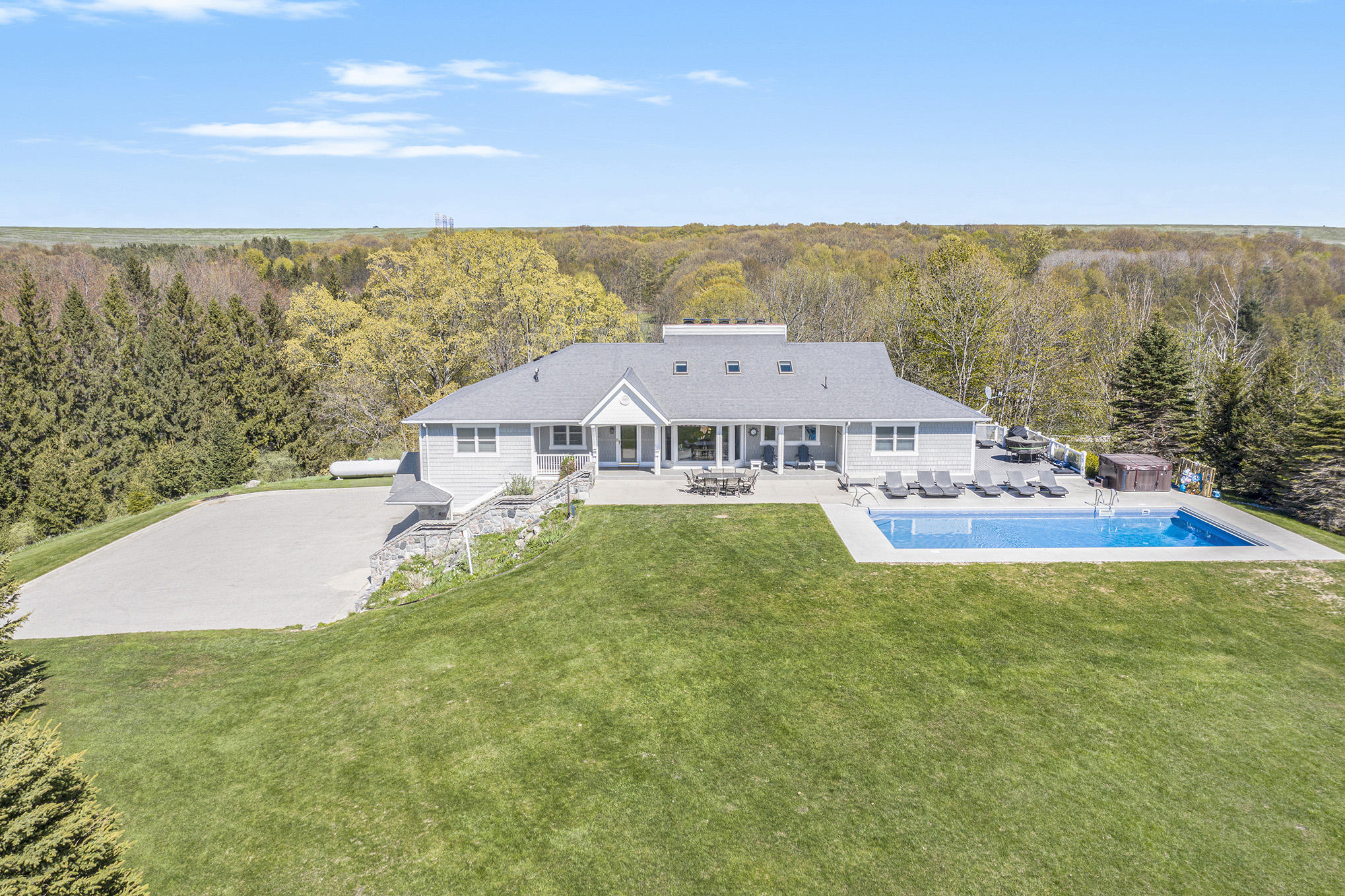 Gorgeous Lake Michigan retreat with 318 feet of frontage 7 acres located close to the towns of Ludington and Pentwater to enjoy marinas, restaurants, shopping, and all that the lakeshore has to offer. This home was custom built by a lumber baron and showcases true craftsmanship with redwood beams, pecan accent details, and old-world character that is rarely found. The Chef's kitchen offers, a copper hood over a cooktop, 4 ovens, ample cabinetry, fireplace, and views of the water from every angle. The main floor offers a four-season porch, dining, and beautiful brick fireplace in the living room perfect for cozy summer evenings after the sunset. With 4 bedrooms, including a master suite, complete with a custom closet, there is You will love the lower level ready for entertaining with an additional Double-sided fireplace offering ambiance in both the recreation area and the billiards room near the wet bar perfect for guests to enjoy refreshments after a day at the pool. Don't miss the sauna and fitness rooms. The spacious in-ground pool that is easy to maintain and offers expansive views of Lake Michigan. This one-of-a-kind offering is waiting for new owners for either rental/investment opportunity or as a personal get-a-way or primary home. Rated #1 by GRKids.com for Best Summer Vacation Rental!! Call today for your private showing and get ready to relax and enjoy the views! Sale to include parcels 014-110-021-00 & 014-110-004-51