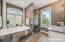 Master bathroom offers separate sinks, garden tub and stand up shower.