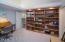 Built-in shelves, custom lighting.