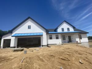 Beautiful NEW CONSTRUCTION by Koetje Builders.  This home is situated on 10.37 Acres in Jamestown Township, Hudsonville Schools.   Great setting with the home set back from the road with ample room in front and back to utilize for outbuildings and other hobbies you have.  Home features 5 bedrooms, 3.5 baths with 3247 sq ft finished with another 928 sq ft of additional room to finish if desired.  Popular open floor plan and large rooms with high end finish quality including custom wood work and cabinets, ceiling details, and fireplace.   Other parcels available as well to build your custom home. Fast fiber internet.  And natural gas coming soon!