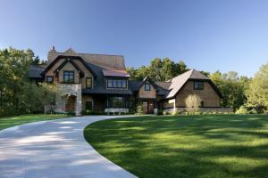 This former Design Home of the Year is situated on a 2.5 acre cul-de-sac site in gated Darby Farms. No expense was spared in this custom designed, Visbeen Architects home built by LaCati Custom Homes. Oversized trim/moldings, two 42'' rumford full masonry fireplaces, wet bar, wine cellar, home theater, game room area, home management/craft room, beamed & paneled dining room. Gourmet kitchen complete with Wolf appliances & an expansive island. Large primary suite with arched cedar beamed ceiling & dual walk-in closets. 4 stall garage. Sitting deck, paver patio, in floor radiant heat, and an elevator shaft. Seller spent $80k recently in improvements including 2 new AC units, all new carpet, paint, privacy fence, & boiler system.This home exemplifies premium West MI craftsmanship.