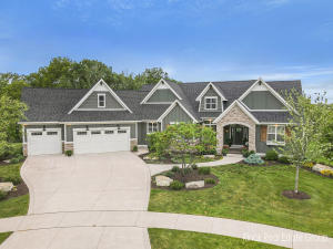 This masterpiece home where quality craftsmanship and beauty meet is ideally located between Grand Rapids and the lakeshore. With 4.67 acres, the property is perfectly placed at the end of a cul-de-sac and backed up to gorgeous woods with trails, offering breathtaking views and privacy. No expense has been spared on this award winning 2017 parade home! Beautifully designed open floor plan. Main floor includes a Chefs kitchen featuring custom built cabinetry; large center island, walk-in pantry, attached 4 season room w/ fireplace, large owner's suite w/attached bath, dual vanities, make up area, in-floor heating, tiled shower and large walk-in closet, office (possible 4th bedroom) has custom built-ins, spacious laundry room w/ sink& cabinetry. Add't features on main floor include great room with fireplace, solid wood doors, soaring coffered ceilings, amazing architectural detail , solid surfaces throughout & attic fan all installed with only the finest of materials and workmanship.Lower-level walk-out is fully finished offering custom built bar, and commercial grade WINE CELLAR, 2 additional bedrooms, exercise room, large family room with built-in cabinetry, work room with double doors to back yard, and additional full bath and ½ bath. Ample storage. Oversized 3-stall attached garage with steps to finished attic access possibility to finish for more living space but perfect for storage. Outdoor living space includes a lower patio and a 3 beautiful 3 season room with fireplace. Firepit area  acres of woods and trails and over 40,000 of professionally landscaped perfection