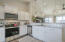 Stock photo - eat in kitchen will have vaulted ceilings, white cabinets, granite counters and tile backsplash.