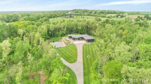 This home and property is exquisite! Jeff Visser designed ranch with attached outbuilding. If you desire living in complete privacy, own a home with many amenities, 13.8 Acres of partially wooded property, this Byron Center home may be perfect for you. Please take a look at the photos and the virtual tour and call me to obtain a list of all the amenities offered! Proof of funds required prior to walk through. Close to M6 & Wilson as well as 100th St and US131, YMCA, Restaurants, Hospitals, and Shopping. Natural Gas available on 100th Street.