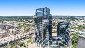 A rarely available 3 bed, 3 bath Grand floor plan condo on the highly desirable SE corner of Riverhouse.  This one is about the ''extras'' and other unique differentiators.   13' 4'' windows with power shades wired and installed overlook Ah-Nab-Awen Park and the rest of downtown Grand Rapids.  This unit comes with a very rare 20' x 22' two car garage with a traditional garage door (drive straight in on the ideal level C, parking fee included in listed association dues).  In addition to the typical basement storage, this unit also includes a 9' x 20' private storage room with 13 ft ceilings to accommodate almost any hobby or storage need. The private 6th floor outdoor balcony is at a very comfortable height with great views.
