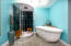 Master bath with soaking tub and ultra modern shower