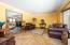Living room featuring intricate wood floor