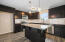 Stock photo - kitchen will have castled cabinets, center island with pendant lighting, granite counters and tile backsplash .