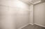 Stock photo- master bedroom, walk in closet.