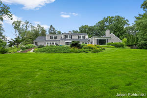 This completely renovated Waterfront Property combines supreme craftsmanship and lake living with no expense spared in the Mark Shuart restoration.  This masterpiece sits on your own private 21-acre sanctuary with wildlife galore and private lake frontage on both Church Lake and Middleboro Lake. Exclusive location at the end of a quiet cul-de-sac, this 5 Bedroom plus an office, 4 full and 1/2 bath home has over 4,800 square feet of living space.  This hidden gem boasts oversized rooms throughout the home including a 1st floor master suite with a grand walk-in closet and connected master bathroom with separate shower and jetted tub.  The open kitchen connects to the family room and extends to the large patio with unobstructed southern views of Church Lake. The in-house elevator services all 3 levels where upstairs you will find 3 generous bedrooms with an abundance of closet space and 2 full bathrooms.  The lower level has a large recreation room with a fireplace, workshop plus bonus rooms.  Additional amenities include an attached 2 car garage, underground sprinkler system, home security system, outbuilding and home generator.  Close to everything Grand Rapids has to offer including Gaslight Village, Frederick Meijer Gardens, downtown Grand Rapids and quick access to the expressways.