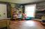 Main floor bedroom, office or playroom.